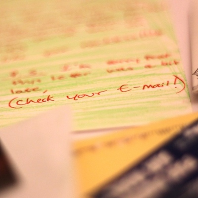 A handwritten note reads 'Check your e-mail!'