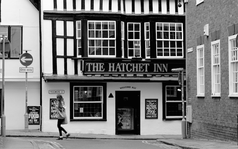 Black & white photo of The Hatchet, tudor pub with a black door