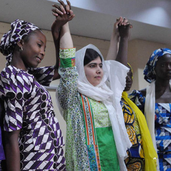 Malala holding hands with Kenyan girls