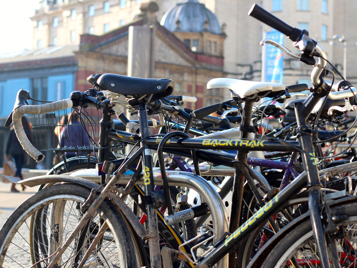 A stand full of bikes in Bristol city centre