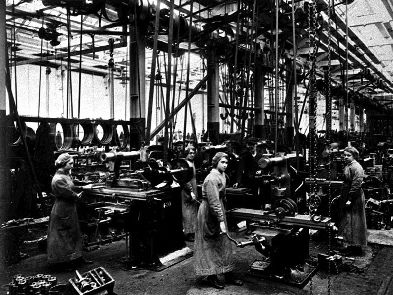 Girls work in a factory using complex & dangerous machinery