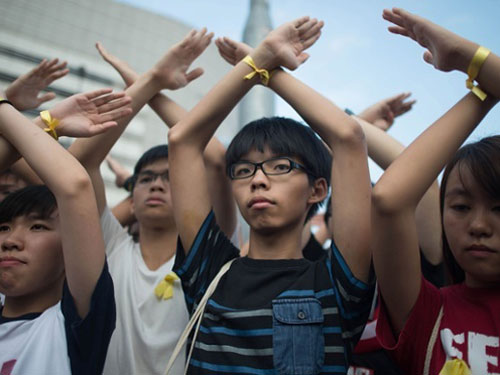 Student protesters in Hong Kong wear yellow ribbons