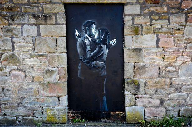 'Mobile Lovers' mural by Banksy