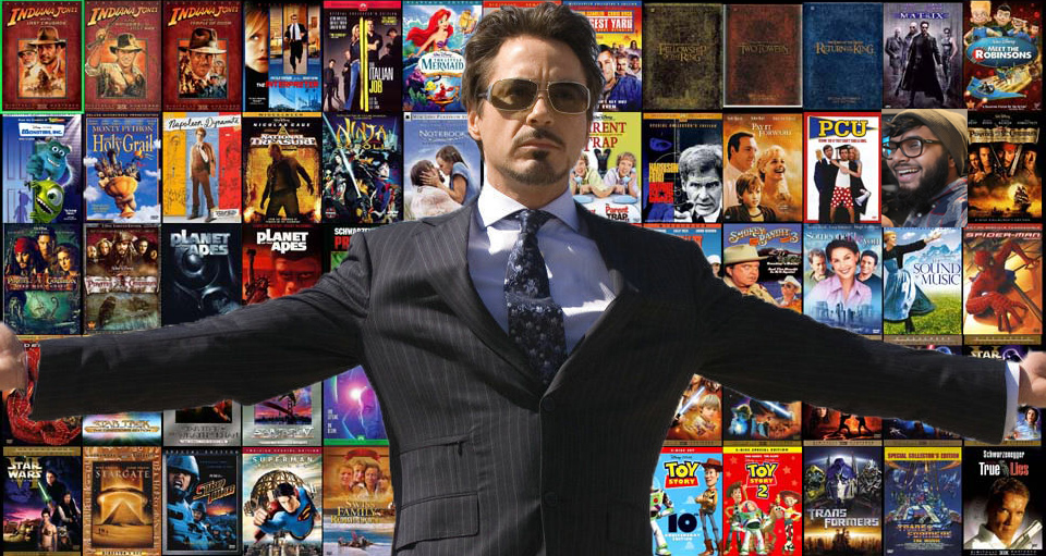 Robert Downey Jr. standing in front of a plethora of DVDs with his arms open