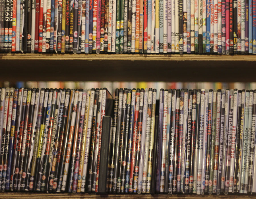 Hundreds of DVDs on a shelf