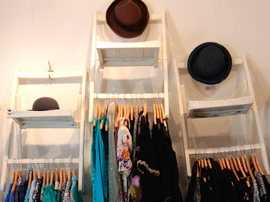 Vintage clothes and hats on a rail