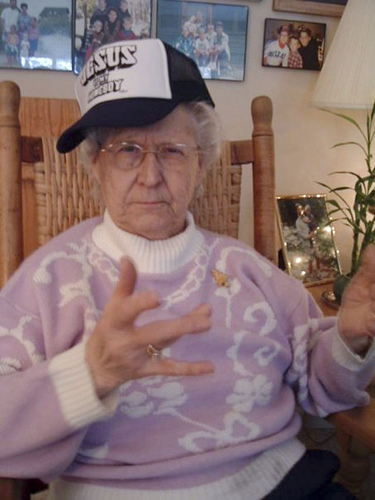 Gangster grandma throwing up gang signs