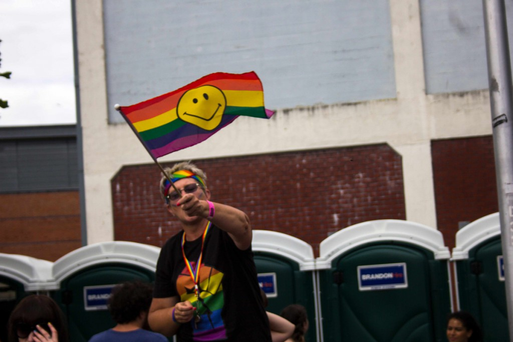 Proudly waving their smiley-face/pride flag.